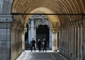Officers patrol the streets of Venice, which saw some stringent lockdown measures eased this week.  By ANDREA PATTARO (S fornasier/AFP)