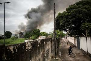 Officials said the fire at the election warehouse in Kinshasa had started simultaneously in two places, blaming it on an arson attack.  By John WESSELS (AFP)