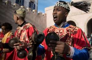 Often dressed in colourful outfits, Gnawa musicians play the guenbri, a type of lute with three strings, accompanied by steel castanets called krakebs.  By FADEL SENNA (AFP)