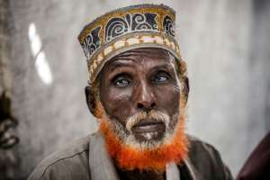 Omar Dule, 74, who lost his house in the floods, is among those who have taken shelter at a UN displacement camp in Beledweyne.  By LUIS TATO (AFP)