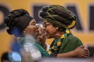 One of the main candidates is Nkosazana Dlamini-Zuma (left), the ex-wife of President Jacob Zuma who is seen here greeting Winnie Mandela, former wife of the late Nelson Mandela