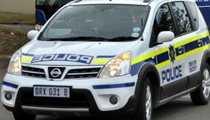 One of the suspects turned himself in at a South African police station, saying he was