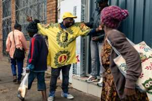 Only a handful of supporters came out onto the streets of Harare, sporting Mugabe-emblazoned T-shirts.  By Jekesai NJIKIZANA (AFP)