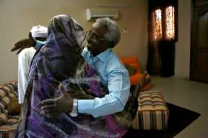 Osman Mirghani is greeted by his sister following his release from jail in late March. By ASHRAF SHAZLY (AFP/File)
