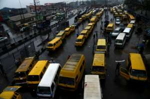 Operators of minibuses, the mainstay of public transport in Lagos, say passengers are unwilling to pay extra to compensate for the fuel hike.  By PIUS UTOMI EKPEI (AFP)