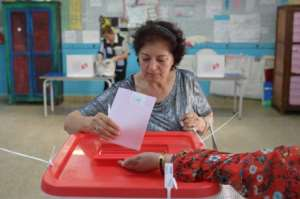 Opinion polls have been banned in Tunisia since July, but one thing appears certain: many voters remain undecided.  By Fethi Belaid (AFP)