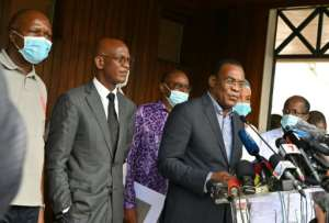 Opposition candidate Pascal Affi N'Guessan, right, announced plans for a 'transitional government' after the contested elections.  By Issouf SANOGO (AFP)