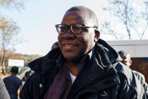 Opposition figure Tendai Biti arrived in handcuffs at Harare Magistrates Court after being deported from Zambia.  By Jekesai NJIKIZANA (AFP)