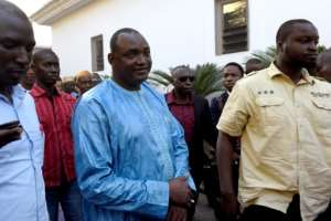 Opposition leader Adama Barrow (C) was declared the winner of the December 1 polls