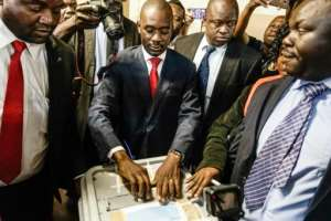 Opposition leader Nelson Chamisa (C) hopes to tap the youth vote.  By Zinyange AUNTONY (AFP)