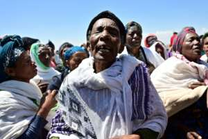 Oromo women perform a traditional chant at the crash site at Hama Quntushele village, in Oromia region. By TONY KARUMBA (AFP)