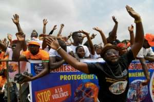 Ouattara supporters at a rally outside of Abidjan. In Ivory Coast as elsewhere in Africa, spontaneous change in favour of younger, brasher leaders is a most unlikely scenario.  By Issouf SANOGO (AFP/File)