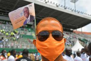 Ouattara supporters say his third term is not unconstitutional as the opposition says.  By Issouf SANOGO (AFP)