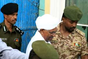 Ousted Sudanese president Omar al-Bashir outside the Kober prison in Khartoum in June, ahead of an appearance at the prosecutor's office.  By Ebrahim Hamid (AFP/File)