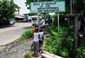 Outside the migrant detention centers in Tapachula, a neighborhood has sprung up housing poor Mexicans and migrants navigating the country's legal system.  By ALFREDO ESTRELLA (AFP/File)