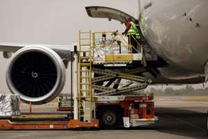Oxford/AstraZenica Covid-19 vaccine doses are offloaded from a plane after its arrival in Abuja, Nigeria, on March 2, 2021.  By Kola Sulaimon (AFP)