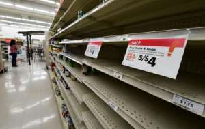 Panic-buying has been seen around the world as people stock up on essentials fearing a lengthy period of enforced quarantine.  By Frederic J. BROWN (AFP)