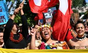 Pacific Islanders marched in Sydney in one of the first protests in a global day of action on climate change.  By PETER PARKS (AFP)