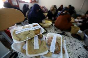 Packets containing food and carrying messages of support are piled up as women prepare iftar meals for fighters of Libya's Government of National Accord (GNA) in Misrata, 200 kilometres (120 miles) from the battle south of the capital Tripoli. By Mahmud TURKIA (AFP)