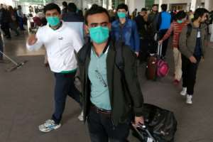 Pakistani students wearing protective face masks arrive from China at Islamabad International Airport. Pakistan is one of the few countriers to maintain flights to China during the crisis.  By Aamir QURESHI (AFP/File)