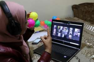 Palestinian teacher Jihad Abu Sharar conducts an online class from her home in the occupied West Bank.  By Hazem BADER (AFP)