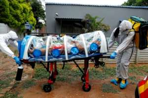 Paramedics take a man showing symptoms of COVID-19 to hospital near Pretoria in South Africa. A new strain of the virus that emerged in the country is already spreading around the world.  By Phill Magakoe (AFP/File)