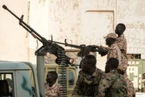 Paramilitaries of the Rapid Support Forces, in their trademark pickup trucks mounted with anti-aircraft or heavy machine guns, have deployed outside key buildings in cities across Sudan.  By Yasuyoshi CHIBA (AFP/File)