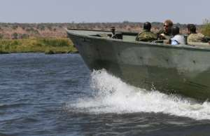 Patrol: The duke joined an anti-poaching unit on the Chobe River.  By MONIRUL BHUIYAN (AFP)