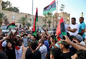 People celebrate in the Libyan capital Tripoli on June 4 after the UN-recognised Government of National Accord (GNA) said it was back in full control of the capital and its suburbs.  By Mahmud TURKIA (AFP/File)