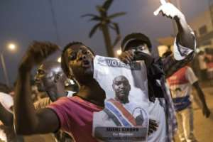 People celebrate the inauguration of Gambia's new President Adama Barrow in Banjul on January 19, 2017