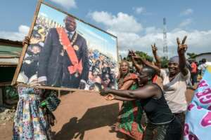People celebrated in the Ivory Coast after former president Laurent Gbagbo was acquitted by the International Criminal Court.  By Sia KAMBOU (AFP)
