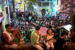People attend a samba concert in Pedra do Sal -- in the background is graffiti depicting Zumbi Dos Palmares, who became a symbol of the fight against slavery in Brazil