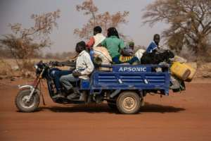People flee with their belongings after a jihadist attack in rural northern Burkina Faso in April. Nearly a million people have been displaced.  By OLYMPIA DE MAISMONT (AFP)