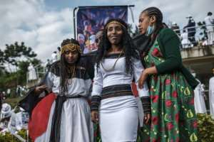 People in traditional clothing pose for pictures during the Oromo people's thanksgiving holiday, in Addis Ababa. It comes against a backdrop of unrest and political division..  By EDUARDO SOTERAS (AFP)