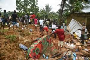 People search for survivors and bodies in the rubble of their former homes.  By SIA KAMBOU (AFP)