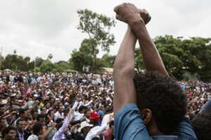 People protest against the Ethiopian government during Irreecha, the annual Oromo festival.  By Zacharias ABUBEKER (AFP/File)