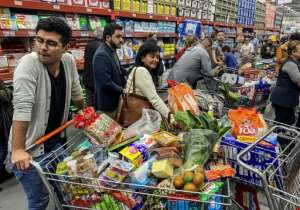 People rush to buy food and supplies in a supermarket before quarantine hits in Bogota, Colombia.  By Daniel MUNOZ (AFP)