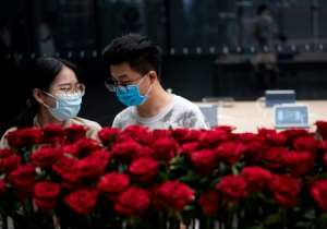 People wearing protective face masks in Shenzhen, China, on May 19, 2020. Chinese officials have accused US President Donald Trump of trying to damage the World Health Organization for political ends.  By NOEL CELIS (AFP)