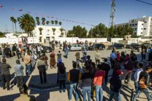 People took to the streets of Sidi Bouzid again this October, to demand stable employment, as the ten year anniversary of the revolution approached.  By Fethi Belaid (AFP)