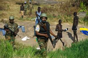 Peacekeeper troops from Ethiopia deployed by the United Nations Mission in South Sudan (UNMISS) patrol on foot outside the premises of the UN Protection of Civilians (PoC) site in Juba, South Sudan, on October 4, 2016