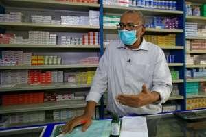 Pharmacy owner Abdulaziz Othman bemoans the acute shortage of medicines at his drugstore in the Sudanese capital Khartoum.  By ASHRAF SHAZLY (AFP)