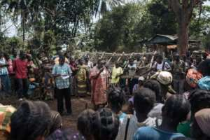 Pierrette Benguere, the head of Mbomou prefecture, speaks to those displaced from Bangassou by the violence.  By ALEXIS HUGUET (AFP)
