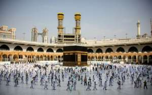 Pilgrims circulate around Kaaba in Mecca's Grand Mosque on Friday, in reduced numbers because of coronavirus.  By - (Saudi Ministry of Media/AFP)