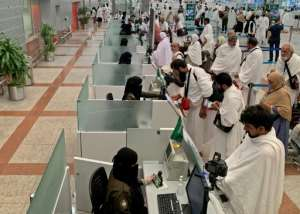 Pilgrims, shown in the Saudi media ministry photo, go through passport control before travelling to Mecca, Islam's holiest city.  By - (AFP)