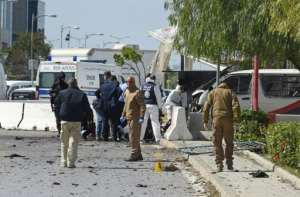 Police and forensic experts inspect the scene of a twin attack near the US embassy in Tunis.  By FETHI BELAID (AFP)