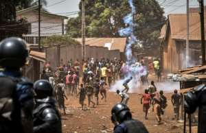 Police and protesters clashed in Wanindara on Thursday in the runup to the referendum.  By CELLOU BINANI (AFP)