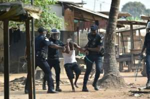Police arrested a man in the district of Yopougon during protests there.  By SIA KAMBOU (AFP)