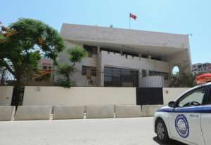 Police guard the Turkish embassy in Tripoli.  By Mahmud TURKIA (AFP)