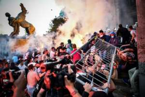 Police fought with outraged demonstrators in Belgrade late on Wednesday, with clouds of tear gas and smoke filling the city centre.  By ANDREJ ISAKOVIC (AFP)
