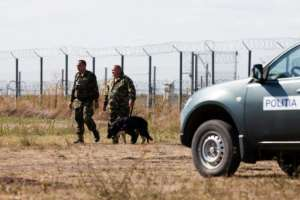 Policemen patrol the border area at Triplex Confinium, where the borders of Romania, Hungary and Serbia meet